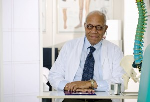 Older Male Doctor Sitting at His Office Desk