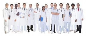 Large group confident doctors standing against white background